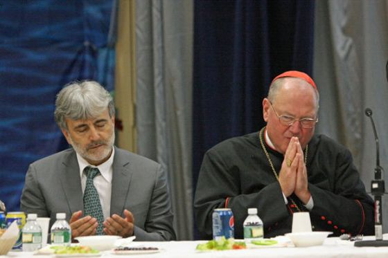 Heretic Cardinal 'Bravo' Dolan praying with his Muslim brotherhood in a New York Mosque!! Dolan like Bergoglio share the same heretical  belief proselytizing is solemn nonsense so he did not even try to convert his brothers but  told the infidels to keep the faith!!