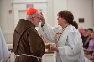 Reaffirming his 'Baptism,' Heretic Cardinal O'Malley is Anointed  from an apostate priestess!