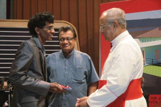 Cardinal Ranjith compliments Vajira Indika Karunasena the symphony's composer
