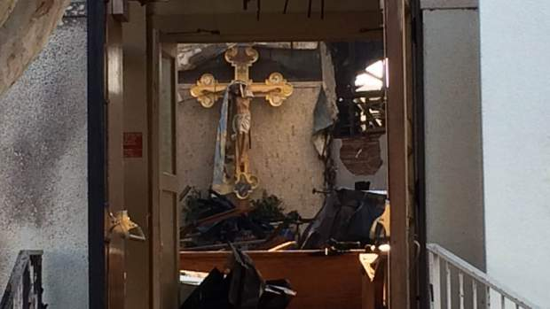 A historic crucifix that survived a 4-alarm fire at Holy Cross Catholic Church in San Jose. (photo credit: Matt Bigler)