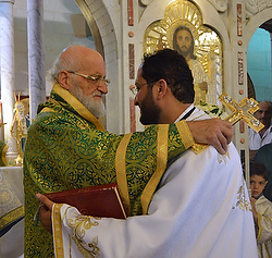 Damascus-based Greek Melkite Patriarch Gregory III Laham embraces Fr Rami Wakim at his ordination in Damascus. Melkite bishops in the West will be allowed to ordain married men as priests again.