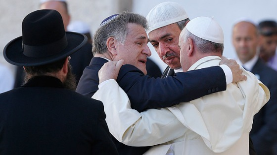 Pope Francis is embraced by Argentine Rabbi Abraham Skorka as he leaves after praying at the Western Wall.