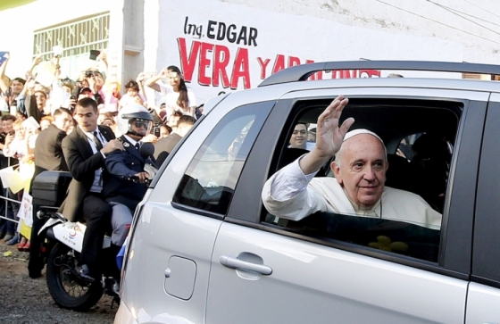 Pope Francis waves as he arrives to visit the Banado Norte neighborhood in Asuncion, Paraguay, July 12, 2015.
