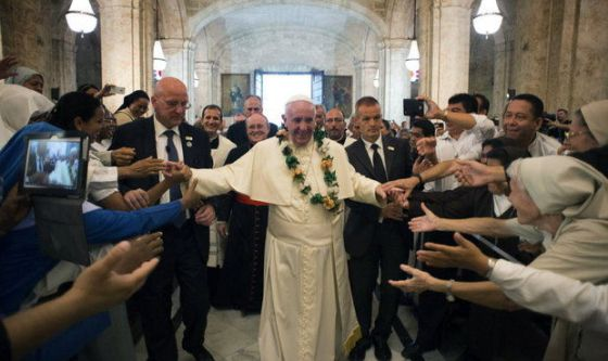 Pope Francis is greeted by faithful as he enters the San Cristobal Cathedral, Havana, Cuba. Francis presided over the evening prayer service in Havana's 18th century cathedral, (L'Osservatore Romano/Pool Photo via AP)