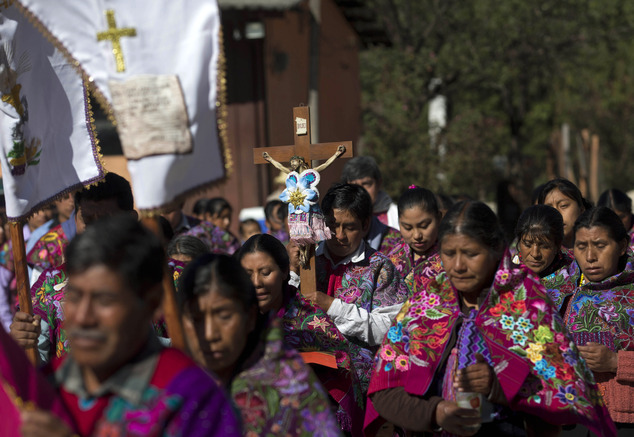 In this Jan. 16, 2016 photo, Tzotzil Indians participate in the procession in honor of the Christ of Esquipulas in Chajtoj, Chiapas state, Mexico. Pope Francisí visit to the heavily indigenous Mexican state of Chiapas appears aimed at celebrating the regionís ìIndian church,î a mix of Catholicism and indigenous culture once considered a thorn in the side of standard liturgy by the Vatican. (AP Photo/Eduardo Verdugo)