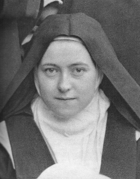 detail-of-st-therese-of-the-child-jesus-in-the-photograph-taken-in-the-courtyard-of-the-monastery-of-lisieux-easter-monday-april-15-1894